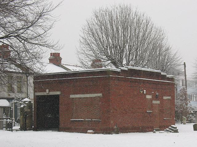 Mitcham churchyard: brick building
