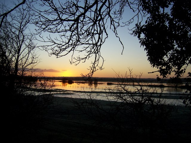 Sunrise over flooded fields.