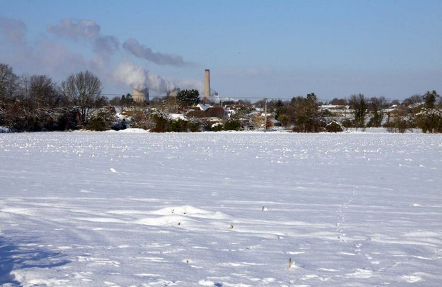 Looking across a snow covered field towards Didcot
