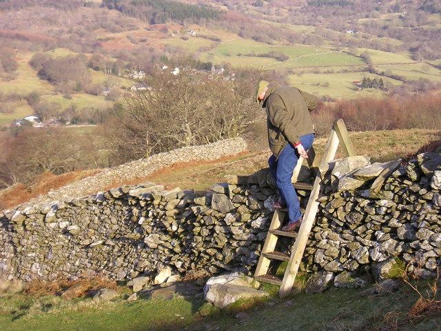 Snowdonia: hiker descending a ladder stile