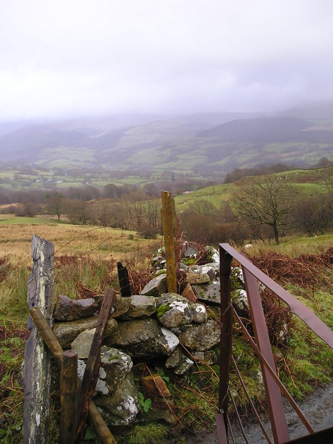 Rusting gate, tumbled wall and valley view