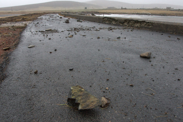Debris in the road at Haroldswick