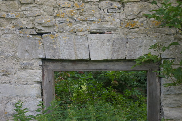 Lintel above the window of an old farmhouse