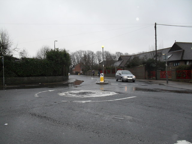Looking across a mini-roundabout towards the Worthing Road