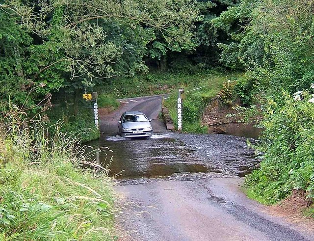 A car crossing the ford on the River Rea