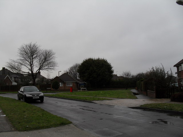 Approaching the junction of  Allangate Drive and Windmill Drive