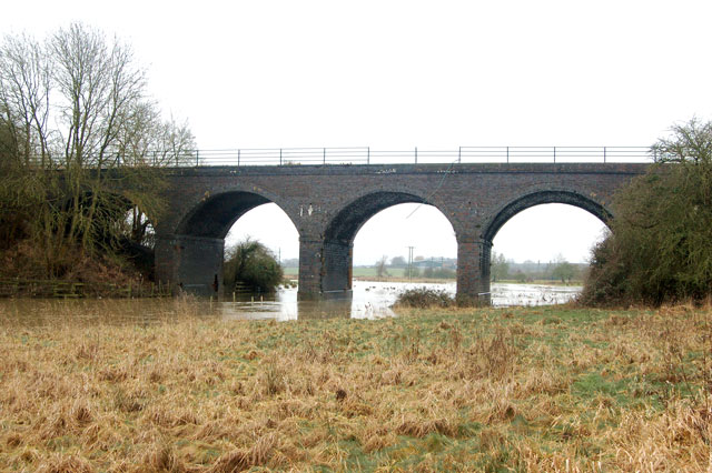 Looking west at the disused railway viaduct near Bascote