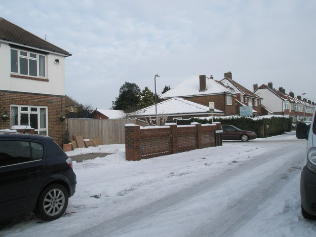 Approaching the junction of a snowy Mansvid Avenue and Tregaron Avenue