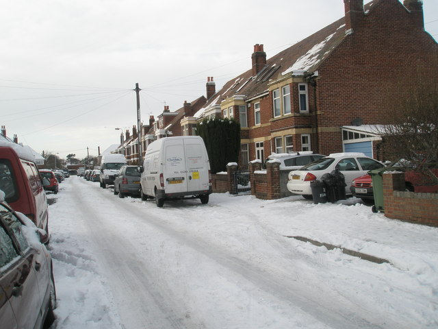 Mid section of a snowy Mansvid Avenue