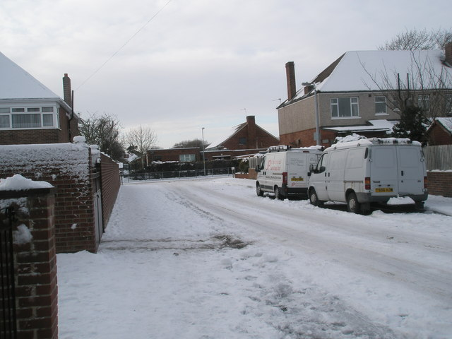 Approaching the junction of a snowy Mansvid Avenue and Court Lane