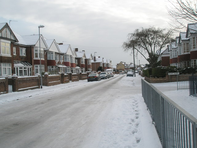 Approaching the junction of a snowy Court Lane and Hilary Avenue