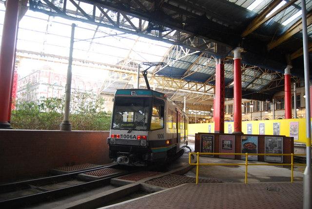 Metrolink tram leaving Victoria Station