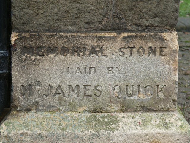 One of four memorial stones on the front of one of the Christ Church buildings on East Street
