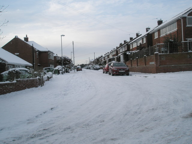 Looking from East Cosham Road into a snowy Courtmount Grove
