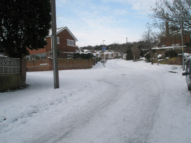 Approaching the junction of a snowy East Cosham Road and Courtmount Grove
