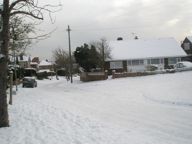 Junction of a snowy Courtmount Grove  and East Cosham Road
