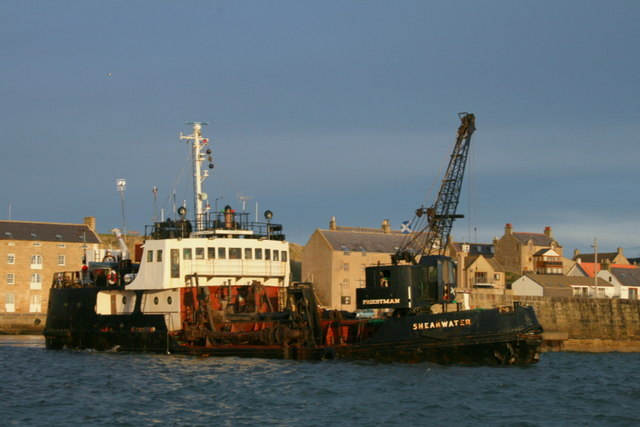 The dredger, MV Shearwater viewed amidships