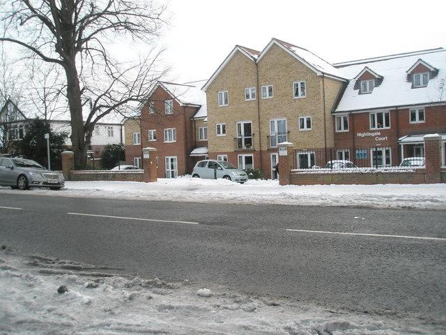 Looking across a snowy Havant Road towards Nightingale Court