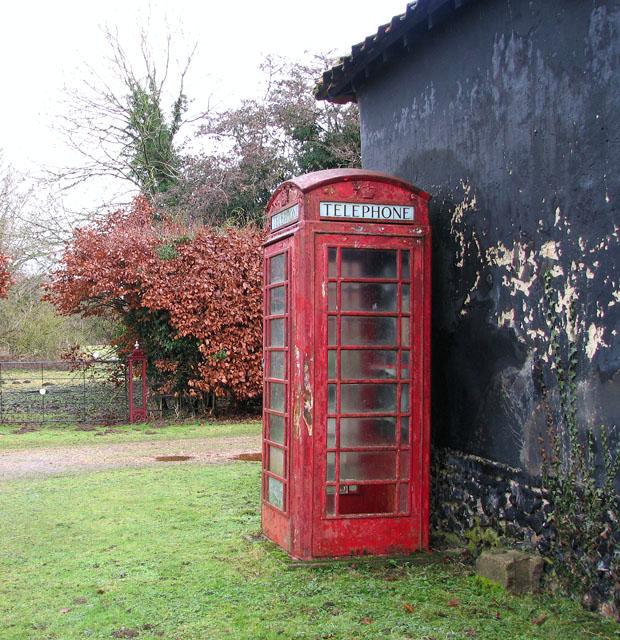 K6 telephone box by old barn at Ivy Wall Farm