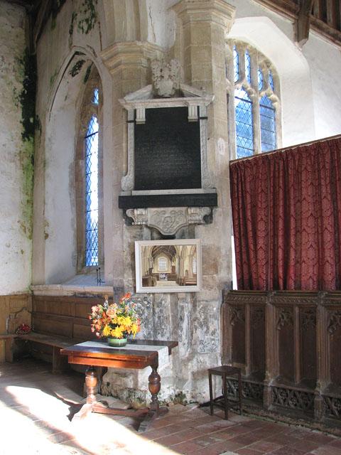 All Saints church - wall monument by chancel arch