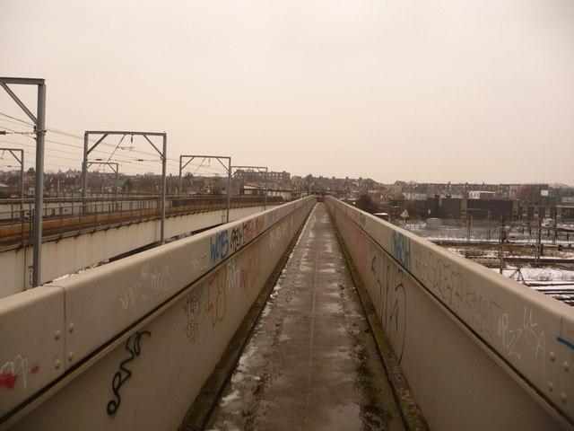 Harlesden: a railway footbridge by Willesden Junction