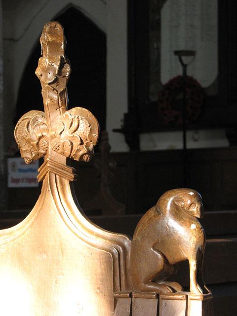 All Saints church - C15 poppyhead bench end and armrest