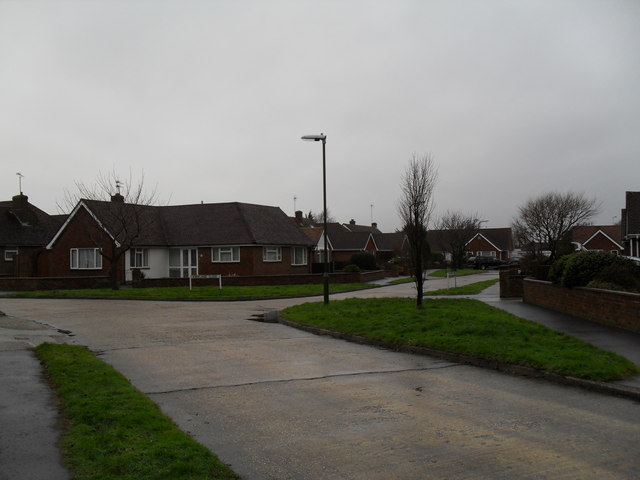 Junction of a snowy Parry Drive and Kirkland Close