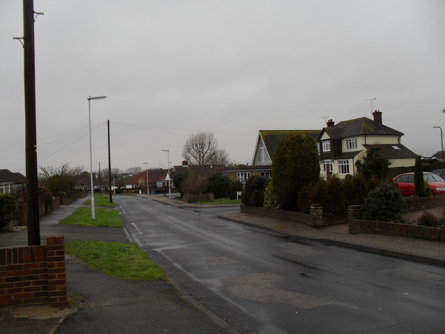 Approaching the junction of  Holmes Lane and Highfield Gardens