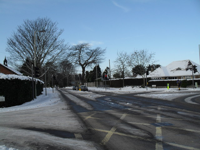 A snowy crossroads at the junction of Emsworth Road, Southleigh Road and Pook Lane