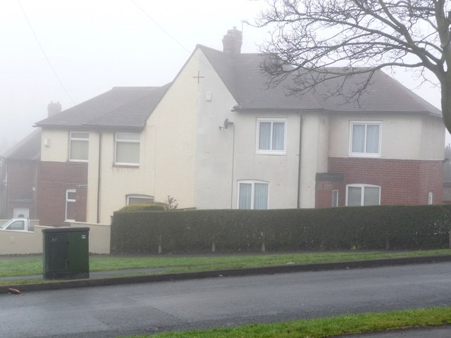 Houses stepping downhill, at the junction of Greenwood Road and Shepley Street