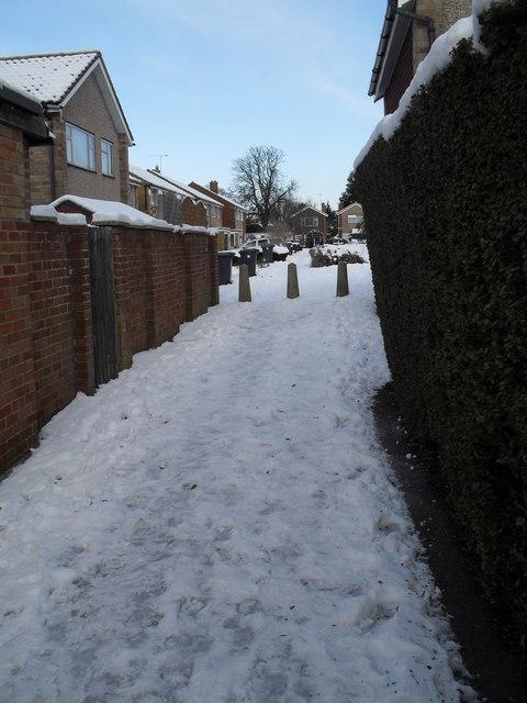 Approaching Tavistock Gardens along a snowy cut through from Bedford Close