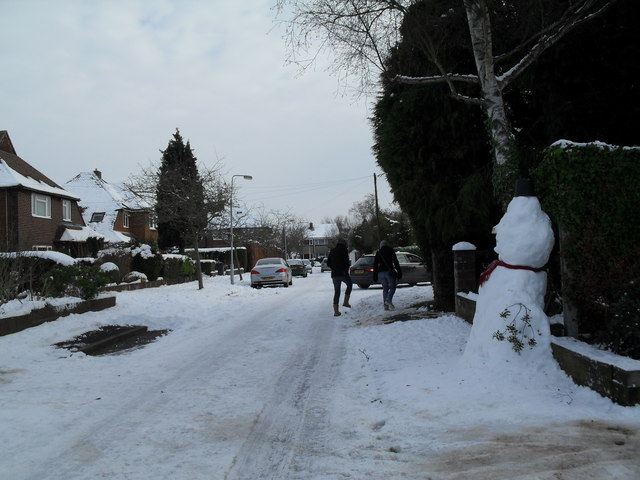 A snowy scene approaching the junction of Pembury Road and Norris Gardens