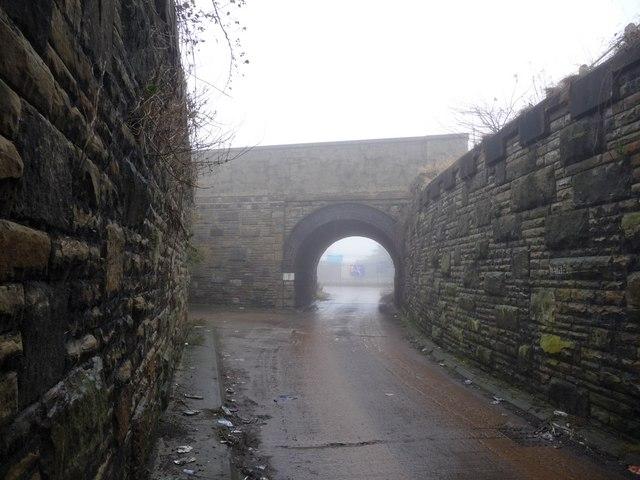 Minor road between two railway bridges, off Calder Vale Road