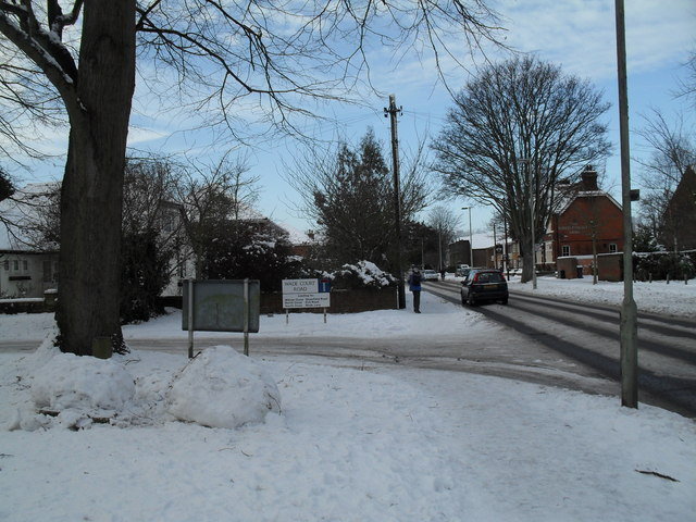 Approaching the junction of a snowy Wade Court Road into Emsworth Road