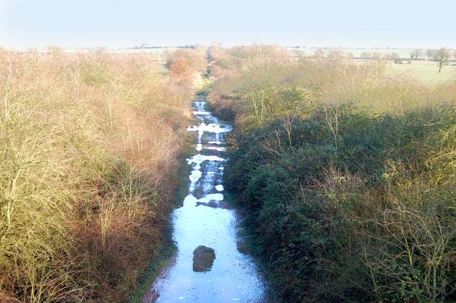 Looking east along waterlogged old railway cutting, Marton Moor