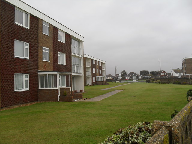 Looking across a grassed area in Sea Road