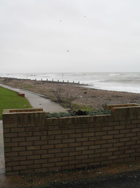 Looking over a wall in Sea Road towards Rustington Beach