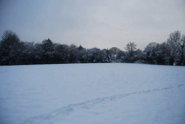 Snow covered field by the footpath to Stockland Green