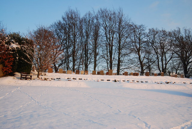 Rows of gravestones in the snow, Bidborough