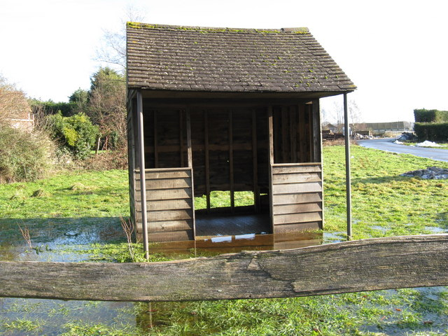 Partially submerged bus shelter at Abingworth