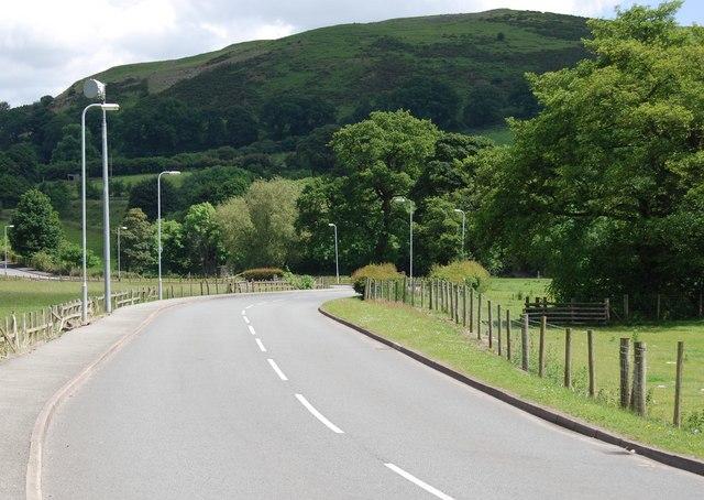 The B5437 towards the Afon Dyfrdwy bridge