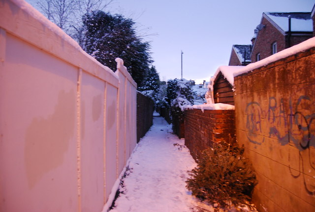 Snowy footpath between the houses, Southborough