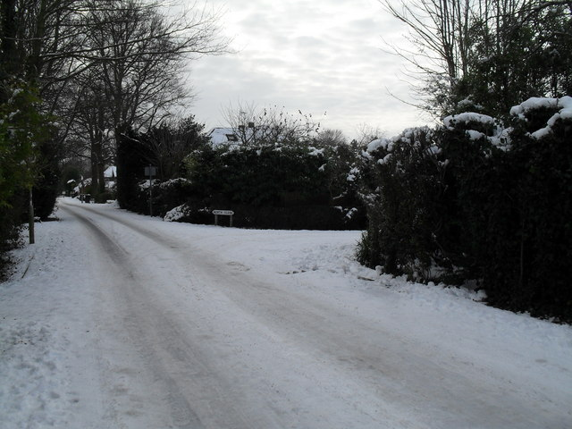 Approaching the junction of a snowy Wade Court Road and North Close