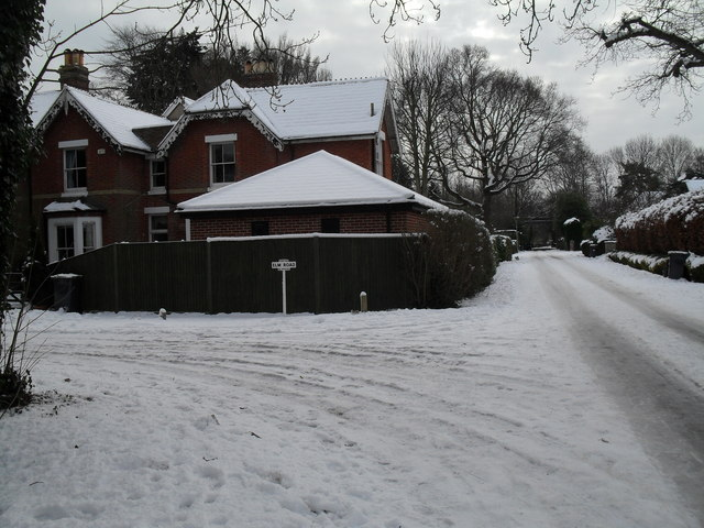 Junction of Elm Road and a snowy Wade Court Road