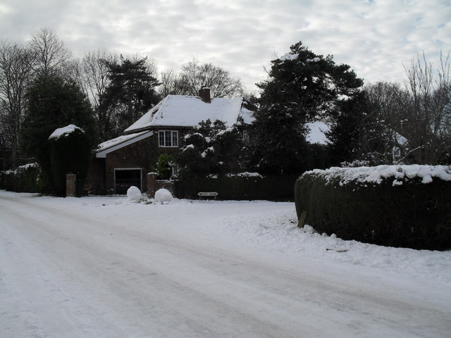 Approaching the junction of a snowy Wade Court Road and South Close