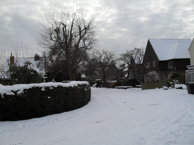 Looking from a snowy North Close into Wade Court Road