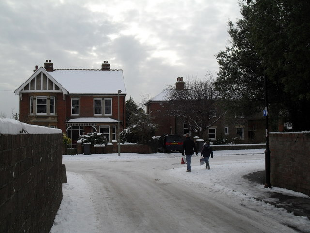 Approaching the junction of Town Hall Road with a snowy Grove Road