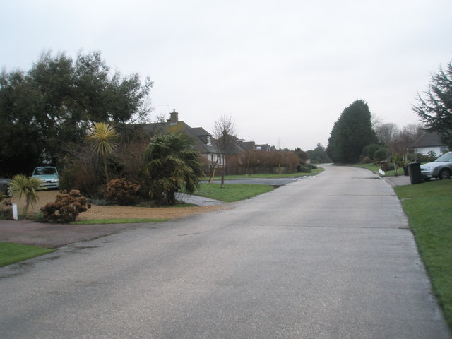 Approaching the junction of  Pigeonhouse Lane and Hudson Drive