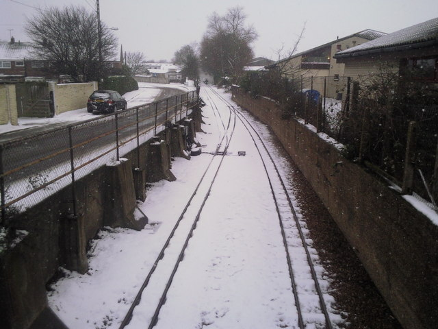 Snowy view from New Romney station road bridge