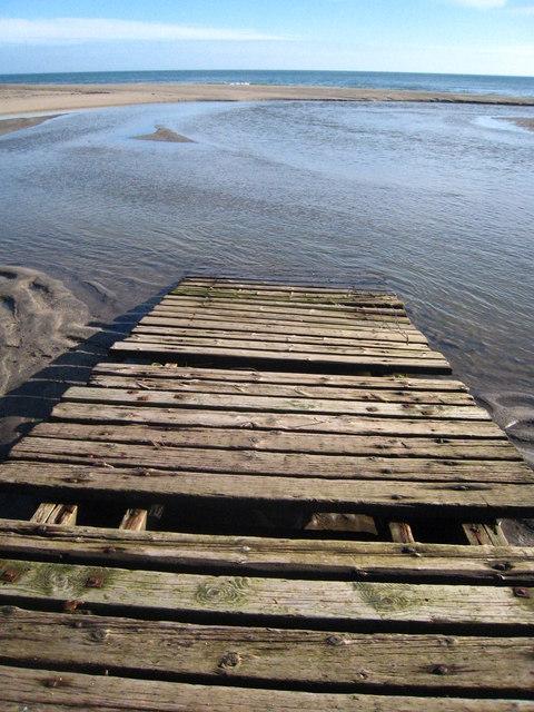 Old wooden slipway on Pentewan Beach